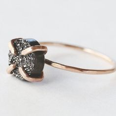 An 8mm gunmetal druzy stone is prong set on a 14K gold fill band. A sparkling ring that you can dress up, down and all around. - 8mm gunmetal black grey druzy - Prong setting - 14K gold fill setting a