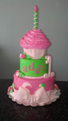 1st birthday cake for a little girl.  I made it to were the cupcake is taken off for the smash.