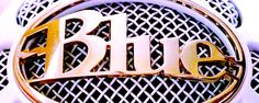 Blue microphone grille lettering.