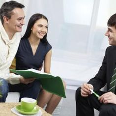 Young married couple meeting with an insurance agent