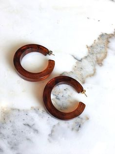 Vintage extra large smoky tortoise hoops slightly tapered and squared with post back. ------- M E A S U R E M E N T S ------- 2.5 length maker/markings: n/a condition: excellent ➸ to shop more vintage jewelry http://www.etsy.com/shop/DearGolden?section_id=7337115 ✩ visit the shop ✩