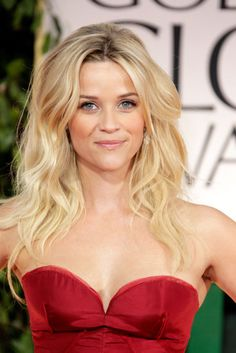 Reese knows what goes with a hot red dress: sexy beachy waves!