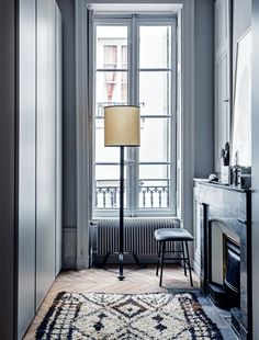 House tour: a modern French apartment within an opulent 19th-century shell: A walk in wardrobe space with plenty of natural light.