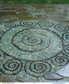 the outer spirals of this design represent the full moons of the year. it's made with green and black pebbles and iridescent glass marbles. Mosaic Walkway, Pebble Mosaic, Stone Mosaic, Pebble Art, Mosaic Pots, Pebble Stone, Landscaping With Rocks, Backyard Landscaping, Landscaping Ideas