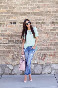 a pastel green top from Topshop, jeans from Current Elliott, shoes from Kurt Geiger, bag from Kate Spade and sunglasses fromKaren Walker