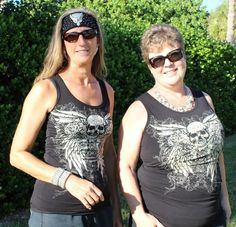 Tank, lace rip back. Black with skull. Look at how cool the same tank top looks on a tall slender gal, or a curvy petite one!  Check out this blinged-out black tank with a skull and pistol design, ripped-out back with lace, wing and gun print.  Black, Cotton Lycra, plus sizes available. Shown here in sizes small and 2X. $36