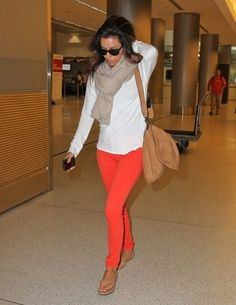 Eva longoria . Orange pants white blouse . #scarf cute outfit