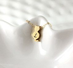 This cute gold cat necklace is hand stamped and personalized with initial of your choice. The reverse side of the cat can be stamped with a 2nd