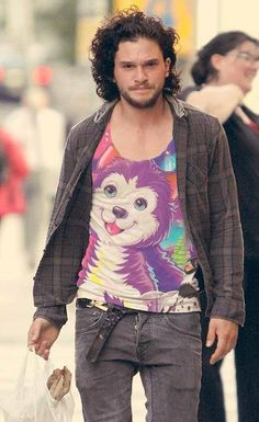 Kit Harrington wearing a T-Shirt of... is that a dire wolf pup?...NO that's Lisa Frank!