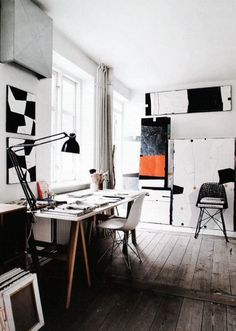 Beautiful workspace filled with artwork.
