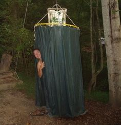 shower enclosure out of a hula hoop and shower curtain liners. - rugged life