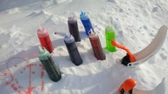 Snow activities for my daughter's sledding party. Food colouring & water in squeeze bottles and snowball makers. Recommend buying good quality squeeze bottles, not dollar store - they leak.