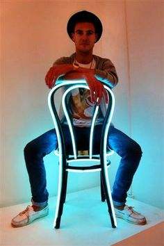 Lee Broom at the London Design Festival 2010 in his Rivington Street studio, with his celebrated neon chair. Photo by Barbara Chandler