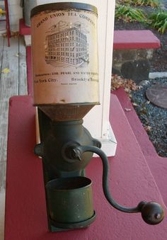 coffee mill, Grand Union Tea Company made of tin & cast iron, was manufactured by the Bronson and Walton Company of Cleveland, Ohio for the Grand Union Tea Company, Brooklyn, New York.