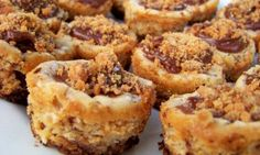 Butterfinger Cheesecake Bites. Easy .LITTLE BITES OF HEAVEN!!! Made with vanilla wafers, butterfingers, peanut butter, cream cheese.