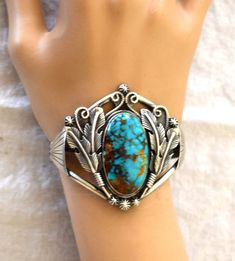 RAYMOND DELGARITO STERLING SILVER TURQUOISE FEATHER CUFF BRACELET