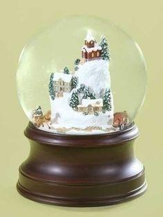 Musical Animated Christmas Village Snow Globe - http://www.christmasshack.com/snow-globes/musical-animated-christmas-village-snow-globe/