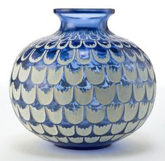 R. Lalique Blue Glass Grenade Vase With White Patina. Circa 1930