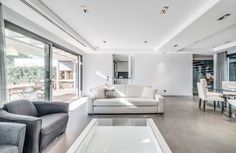 Home Design:Modern Residence With Elegant Private Pool Spacious Vilamoura House Living Room Interior Design Dominated Under White Also Gray Scheme To Keep It Open