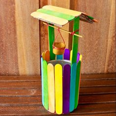 Make a colorful mini wishing well - Follow @Guidecentral for colorful #craft projects