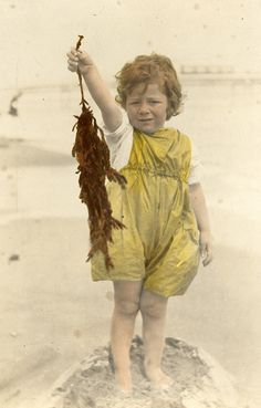 Tinted portrait of a young child at the beach