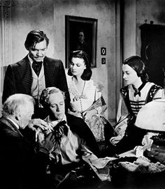 Clark Gable, Vivien Leigh, Leslie Howard and Olivia De Havilland on the set of Gone With The Wind