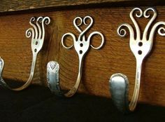 Dishfunctional Designs: Silverware Upcycled & Repurposed: Crafts With Spoons & ForksAgain, lots of ideas for projects with old flatware - yard art, hooks, lights, etc. etc.