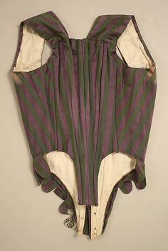 """Round Gown ca. 1795; Met 1979.20a-g. Ensemble includes gown, separate stays, sleeveless spencer, and separate sleeves (probably left over from an earlier styling of the gown), all from the same striped silk satin fabric. Back view of front-lacing """"stays."""" This is an overbodice, not working stays. Fabric repurposed, possibly from original petticoat: hem embroidery on tabs. Back seamed to imitate anglaise pleating. Very narrow back neckline."""