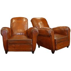 The real deal.  French Leather Club Chairs 1940's