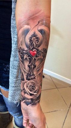 Cross, wings, rose and heart tattoo