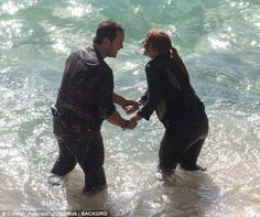 Chris Pratt and Bryce Dallas Howard struggle through the surf as they film Jurassic World: Fallen Kingdom in Hawaii