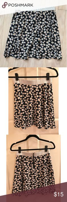 Black and White Flower Mini Skirt A cute Floral skirt is a summer must-have!! Xhilaration brand Mini Skirt, brand new condition. Size Medium, plenty of stretch in the waist for any size. Also has a very cute polka dot detail in the waist band. Xhilaration Skirts Mini