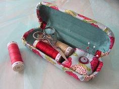 Turn an unused Eyeglass Case into a portable Sewing Kit Case. I need to put one of these in my desk at work.