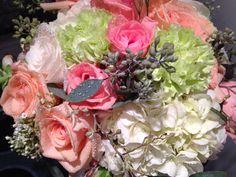 Peach roses, pink roses, bride bouquet