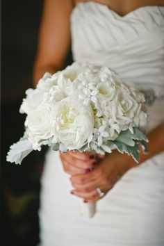 Bridal bouquet of white hydrangea, garden roses, peonies, stephanotis and dusty miller