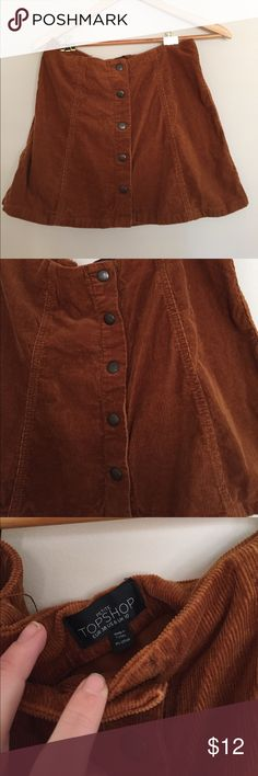 Top Shop corduroy mini skirt Adorable burnt orange corduroy mini skirt was a steal I found! Only wore it once at New Years. I hope someone can provide a home for it! top shop Skirts Mini