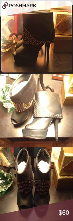 STEVE MADDEN Rockur Peep Toe Booties Black peep toe booties with silver detail. Upper is leather, balance is man made. Worn once. 5 inch heel. great to pair with jeans or dress! Steve Madden Shoes
