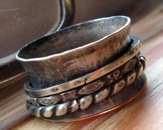 Big fat sterling band with three sterling spinners