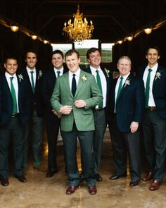 These groomsmen donned navy jackets, dark gray pants, Charles Tyrwhitt shirts, and green knit ties