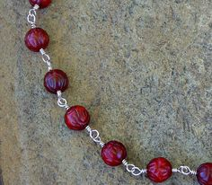 Cranberry carved beads with silver