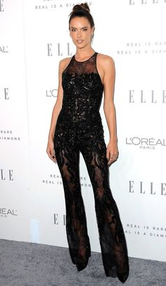 ALESSANDRA AMBROSIO in a black embroidered Zuhair Murad lace jumpsuit, black pumps, a Djula black diamond ring and Joelle diamond ear jackets to ELLE's Annual Women in Hollywood Celebration. Fashion Mode, Suit Fashion, Fashion 2017, Fashion Outfits, Alessandra Ambrosio, Celebrity Red Carpet, Celebrity Style, Sandro, Stunning Wedding Dresses