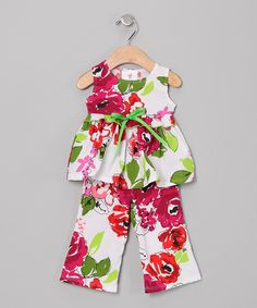This blooming tunic and pant set is great for a day spent on warm-weather adventures. Made of high-quality cotton, the easy-fitting tunic and elastic-waistband pants will keep little ladies happy from sun up 'til sun down.  Size note: This item r...