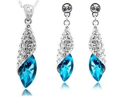 These stunning crystal sets are beautifully designed in the shape of a water drop with a large crystal that gives them a very romantic style perfect wedding jewellery. For effortless accessorising, slip on this gorgeous set of crystal & rhinestones drop earrings and necklace. These glittery gems add an elegant touch to make you sparkle and shine at any party. . #jewelrysets #weddingjewelrysets #bridaljewelrysets