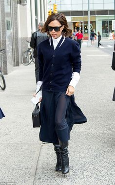 Stepping out: It was business as usual for Victoria Beckham as she stepped out in style in...