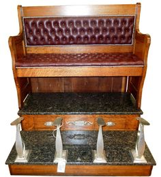 Extremely rare American Koken barber shop supply crescent double seated diamond tufted burgundy leather shoe shine stand with rare marble bottom that has storage drawers; signed