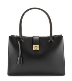 Salvatore Ferragamo - Marlene leather tote - Straightforward, structured and as sophisticated as they come, Salvatore Ferragamo steams ahead with an impeccably sleek aesthetic. Smooth black leather is quietly accented with a gold-tone lock closure and double top handles, making this a worthwhile investment for seasons to come. seen @ www.mytheresa.com