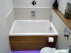 "The Calyx soaking tub set in a narrow bathroom Calyx 1230: 1230mm x 815mm / 48.5"" x 32"" (external dimensions)"
