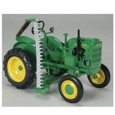 John Deere L with Sickle Mower. Miniature reproduction of a John Deere Model LA. Producing and selling miniatures is a thriving business. Christmas Presents For Boys, Birthday Presents For Boys, Best Gifts For Boys, Christmas Ideas, Outdoor Toys For Boys, Cool Toys For Boys, John Deere Toys, John Deere Tractors, Antique Tractors