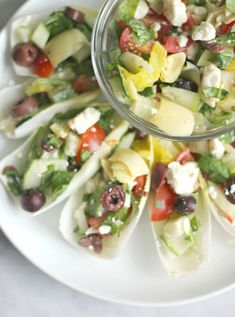 Greek Salad Endive Boats - light flavorful and fresh! Perfect for low cal low carb paleo or whole 30 (by omitting the cheese) Endive Appetizers, Endive Recipes, Paleo Appetizers, Appetizer Recipes, Light Appetizers, Appetizer Salads, Healthy Snacks, Healthy Eating, Healthy Recipes