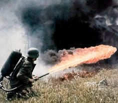 A Wehrmacht flame trooper blasts a spray of hellfire using his Flammenwerfer 41 against a Soviet defensive position located somewhere in Eastern Europe during the initial Summer offensive of Operation Barbarossa in 1941. The German 'Flammenwerfer' was primarily utilized for clearing trenches and other heavily-fortrified positions. It sprayed petrol-doused flaming tar, which stuck to its intended target and dealt an almost inescapable fiery end to its unfortunate victim.